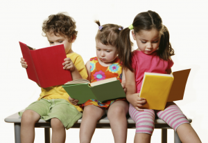 3 kids with books